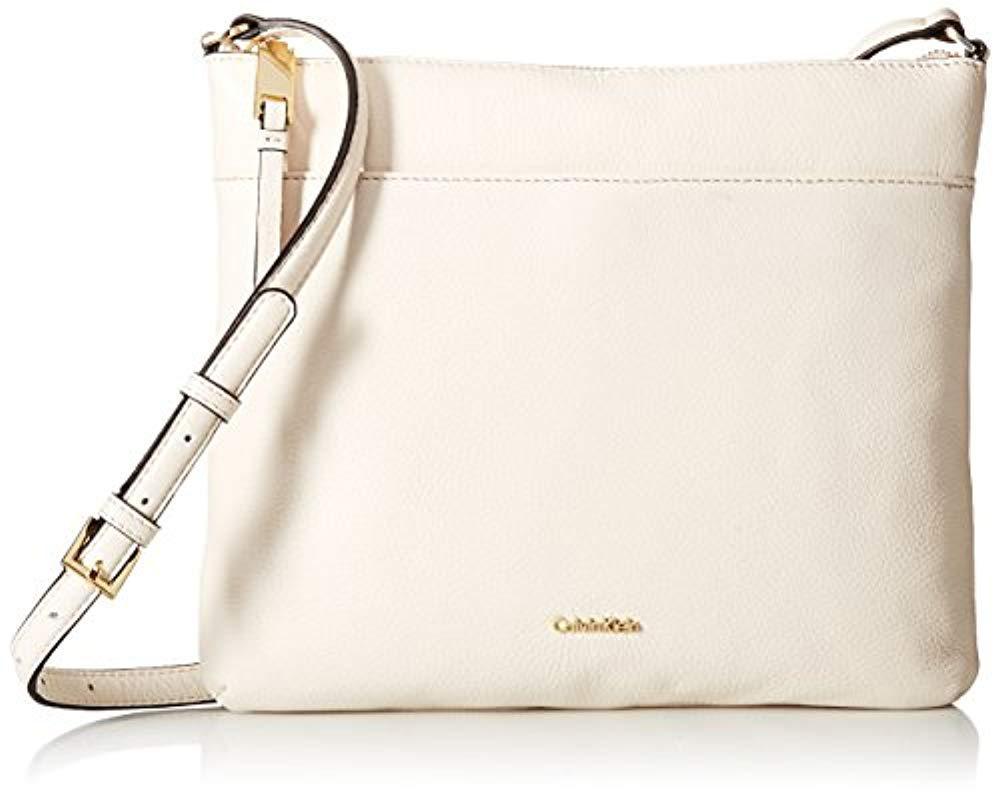 26f3982646af Lyst - Calvin Klein Pebble Top Zip N s Large Crossbody in White ...