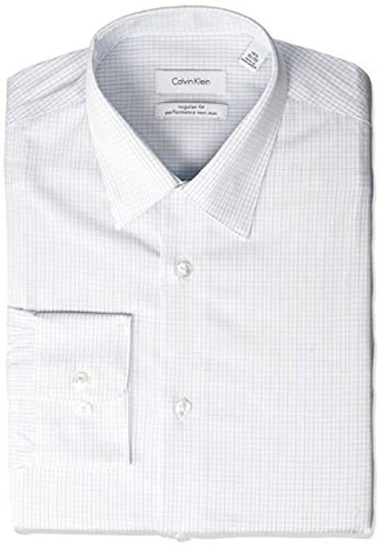 b4fefa8320ac Calvin Klein. Men's Blue Dress Shirts Non Iron Stretch Regular Fit Check
