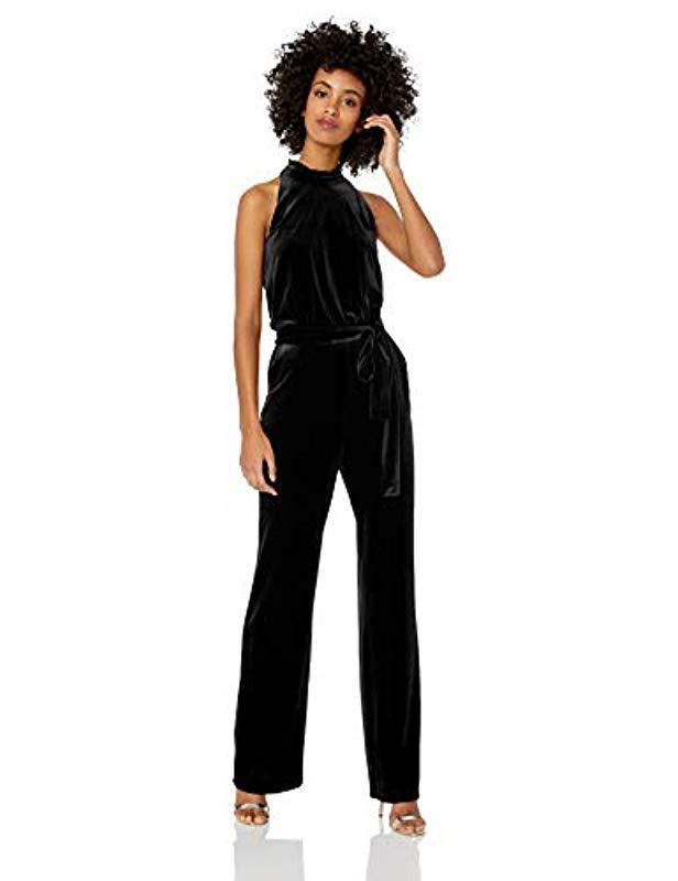 4bbea15559da Lyst - Vince Camuto Velvet Ruffle High Neck Jumpsuit in Black