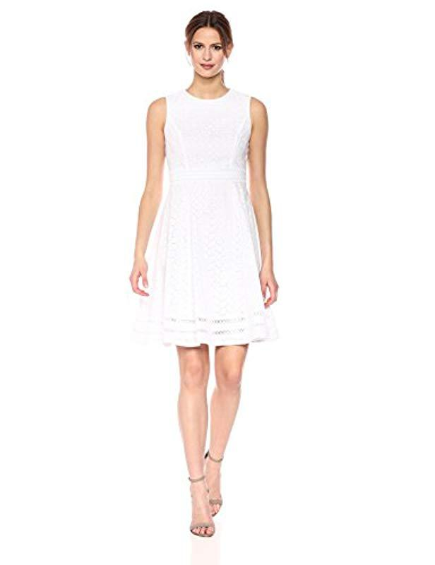 40aa1a14 Calvin Klein. Women's White Sleeveless Cotton Eyelet Fit And Flare Dress