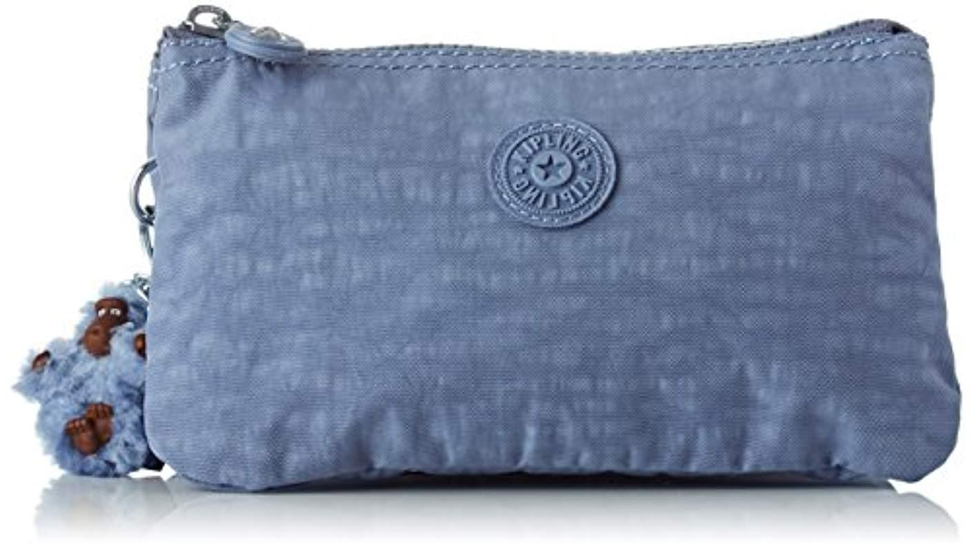 ad309de66c ... Kipling - Blue Creativity L, Purse - Lyst · Visit Amazon. Tap to visit  site