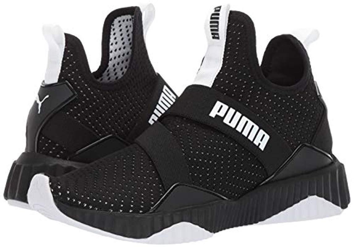 PUMA Defy Mid Core Shoes in Black/White