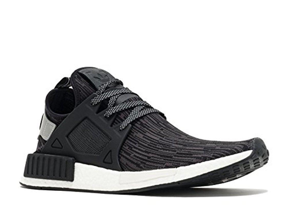 lyst adidas originali nmd rt pk scarpe da ginnastica in nero per gli uomini.
