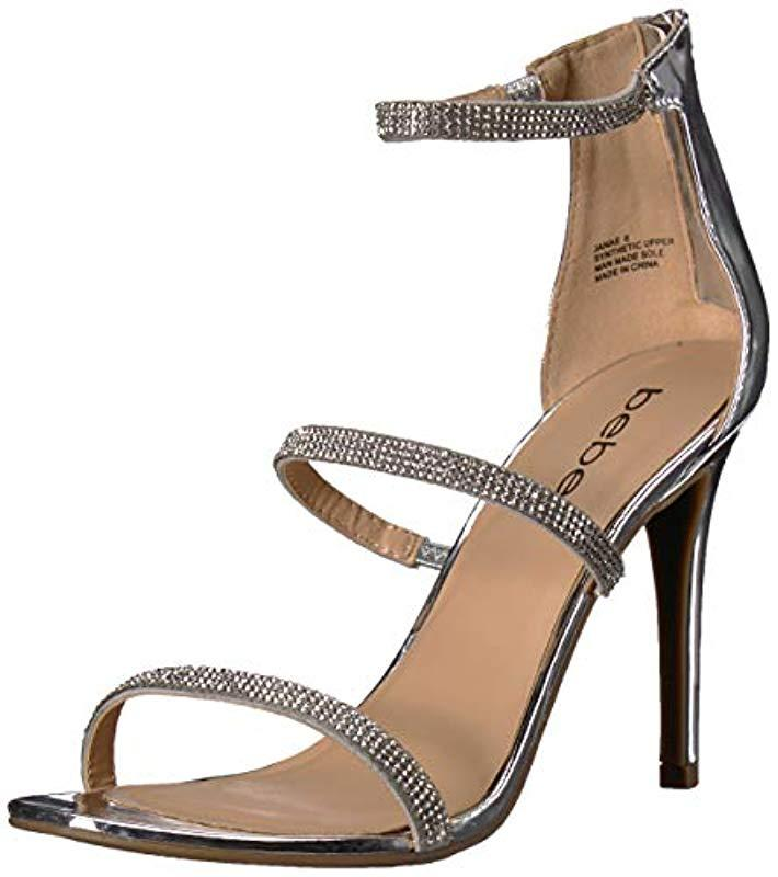 5d209652fce Lyst - Bebe Janae Heeled Sandal in Metallic - Save 21%