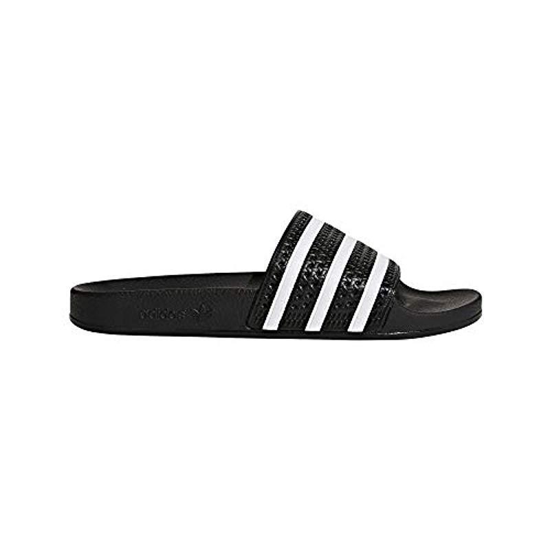 9ac67d4ecc05b8 Adidas Originals Adilette Slip-on Slides in Black for Men - Lyst