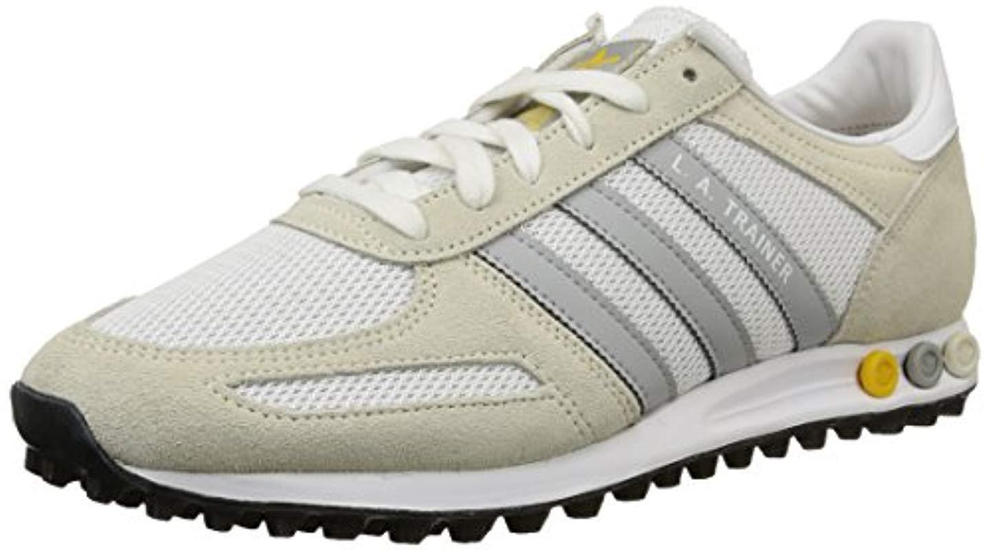 on sale aeef5 f32be adidas. Men s White La Trainer ...