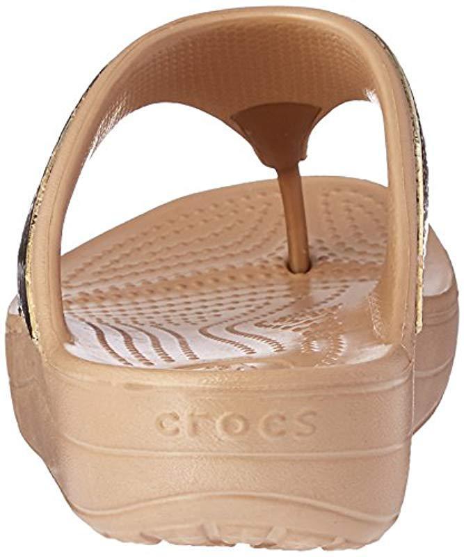 2d9a9f15ac57 Crocs™ Sloane Embellished Flip Flops in Metallic - Lyst