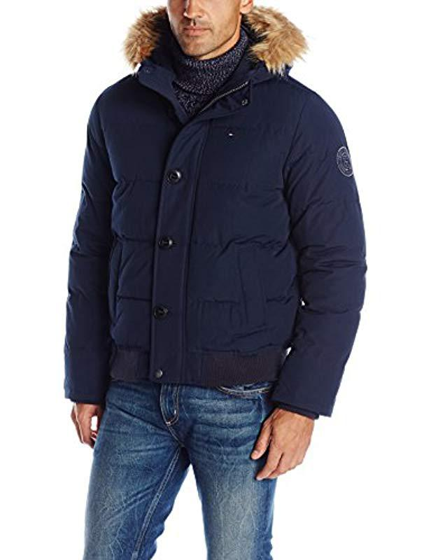32b0dee924390 Tommy Hilfiger. Men s Blue Arctic Cloth Quilted Snorkel Bomber Jacket With  Removable Faux Fur Trimmed Hood