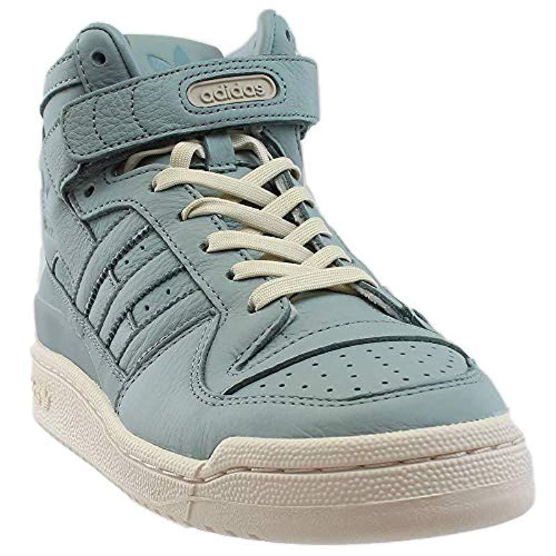 on sale f196e fe34c adidas Originals. Mens Blue Forum Mid Refined Fashion Sneaker