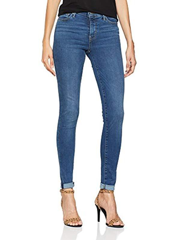f78925f461eb1 Levi s 310 Shaping Super Skinny Jeans in Blue - Lyst