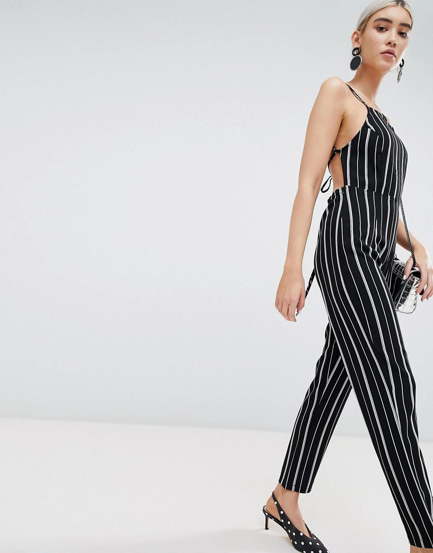 0e6b5593ad2a PrettyLittleThing Stripe Jumpsuit in Black - Lyst