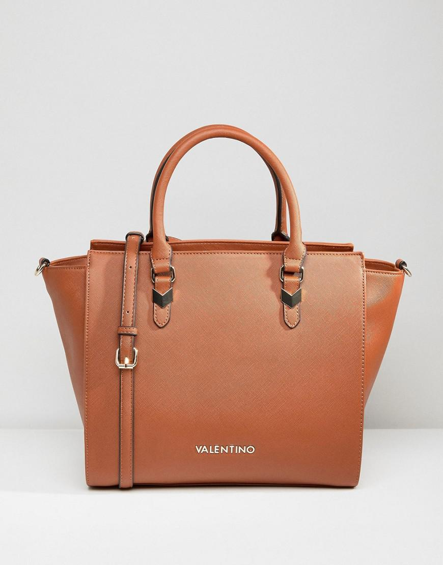 lyst valentino by mario valentino winged tote bag in tan. Black Bedroom Furniture Sets. Home Design Ideas