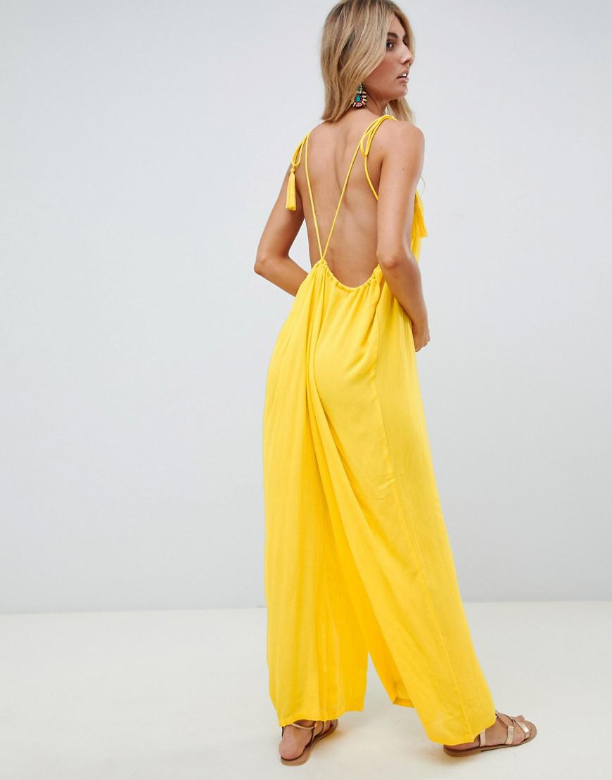 22cc2992d59 Lyst - ASOS Crinkle Low Back Beach Jumpsuit With Tassel Ties In Yellow in  Yellow