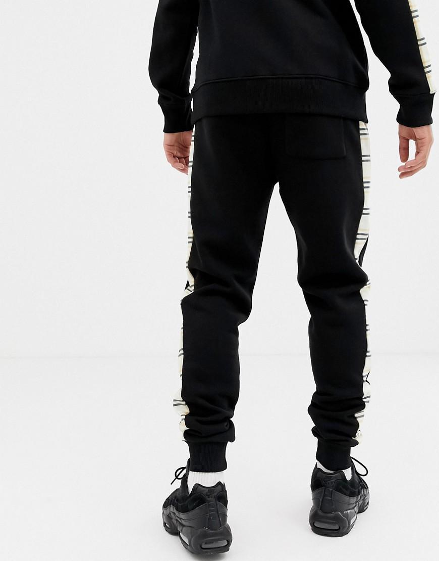 Pantalon de jogging ajusté avec bande à carreaux sur le côté - Noir Coton Criminal Damage pour homme en coloris Noir
