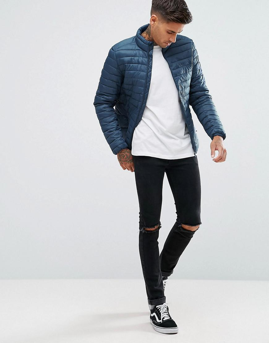 lyst pull bear quilted jacket in navy in blue for men. Black Bedroom Furniture Sets. Home Design Ideas