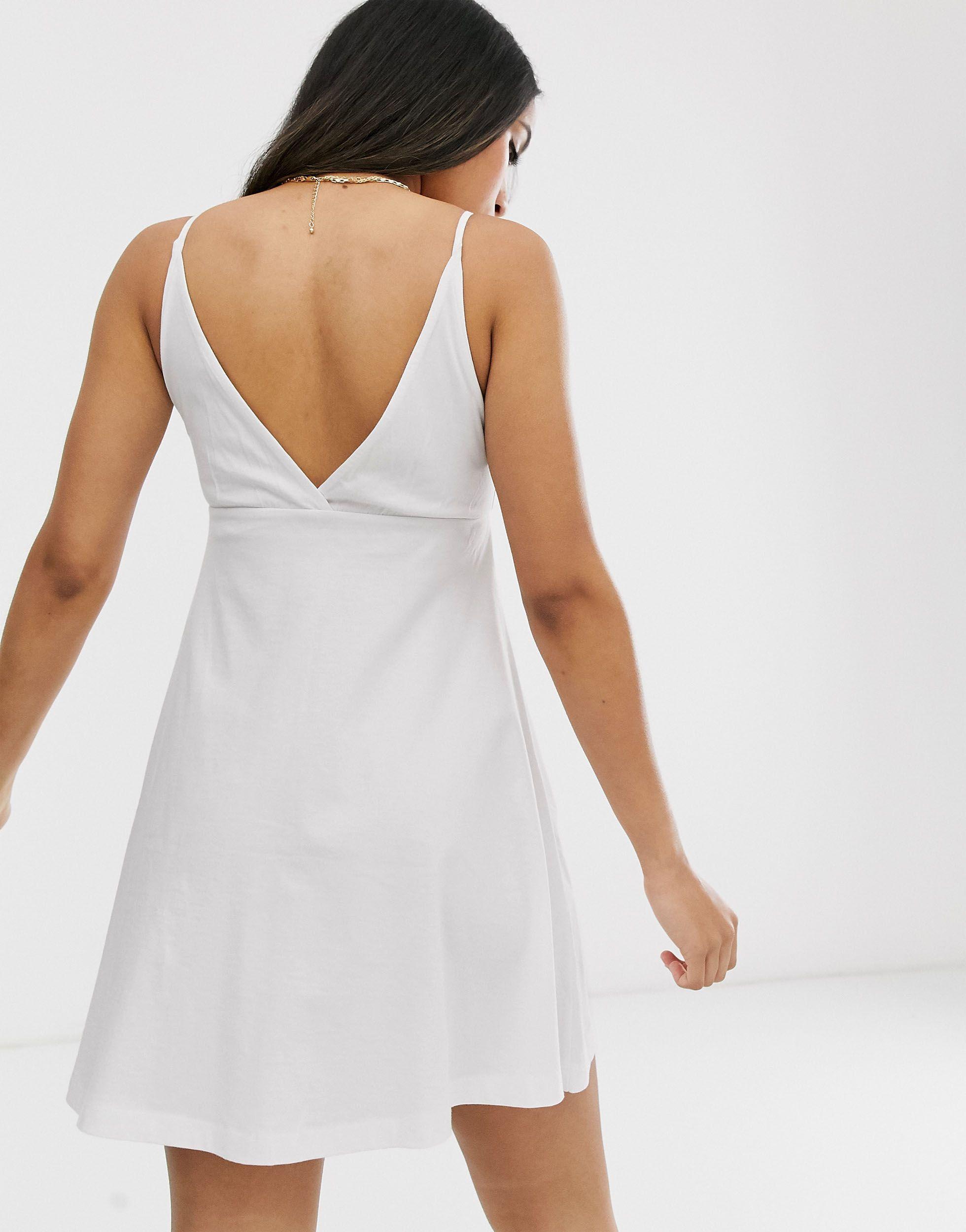 ASOS DESIGN Petite - Robe caraco babydoll courte avec boutons Coton ASOS en coloris Blanc