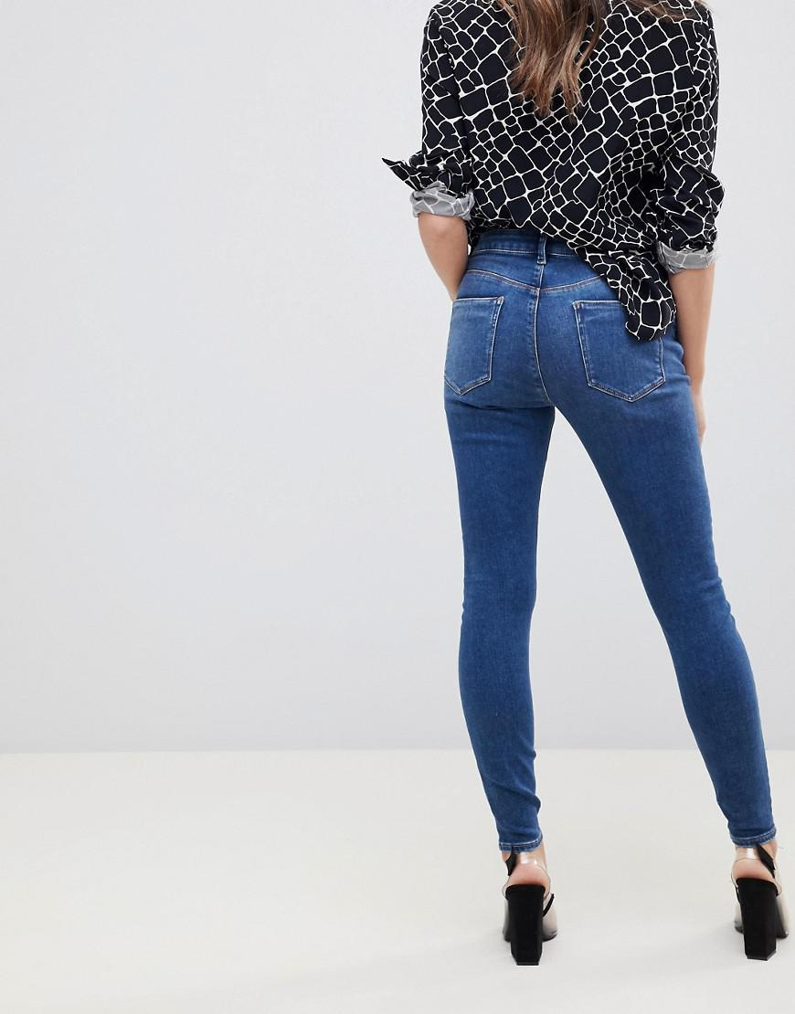 75e1897512 Lyst - ASOS Asos Design Maternity Ridley High Waist Skinny Jeans In Extreme  Dark Stonewash With Ripped Knee And Under Bump Waistband in Blue