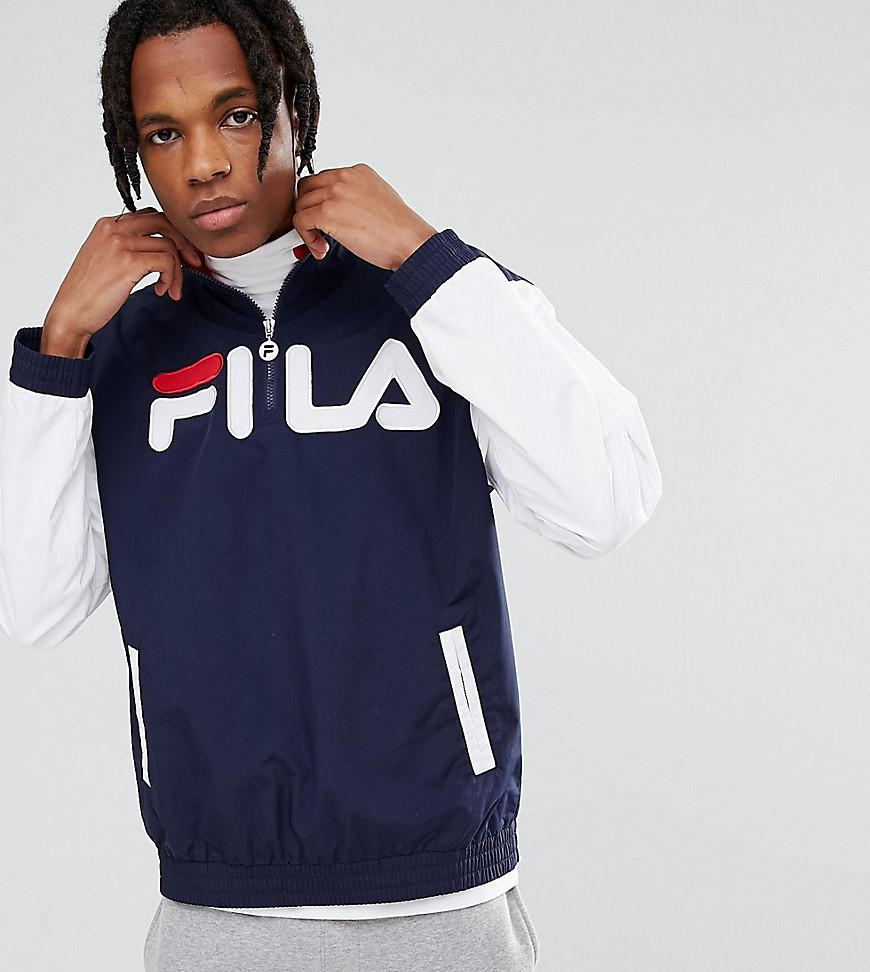 lyst fila fila black line ski overhead jacket with large logo in blue for men. Black Bedroom Furniture Sets. Home Design Ideas