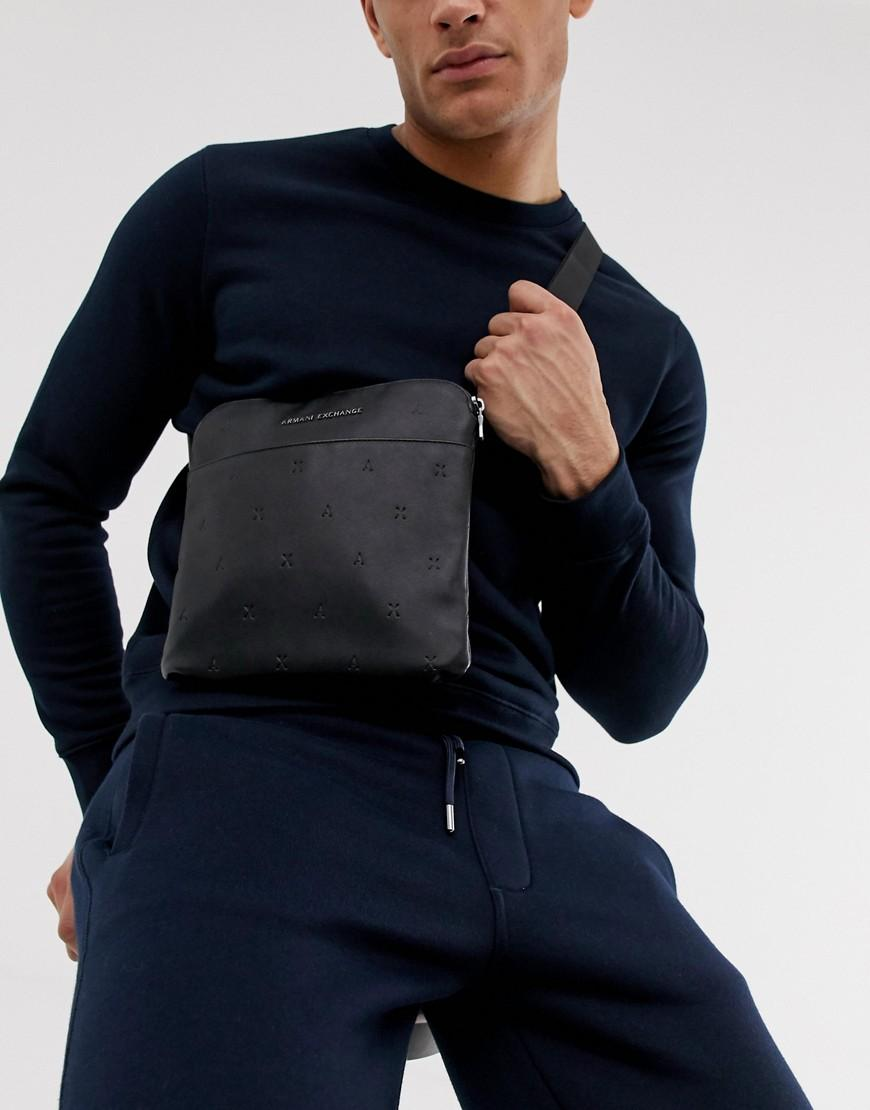 9f535d9dca8 Armani Exchange. Men s Faux Leather All Over Logo Flight Bag In Black
