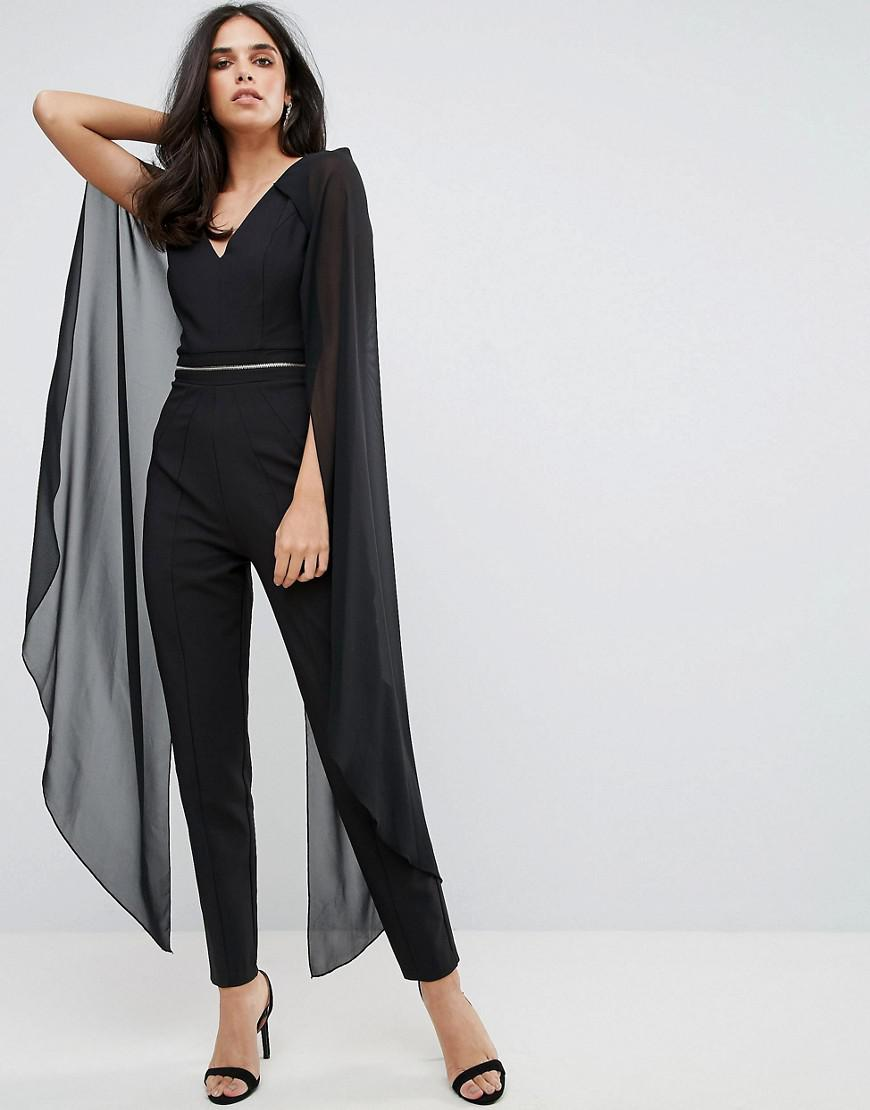 Forever Unique Jumpsuit With Chiffon Cape In Black Lyst