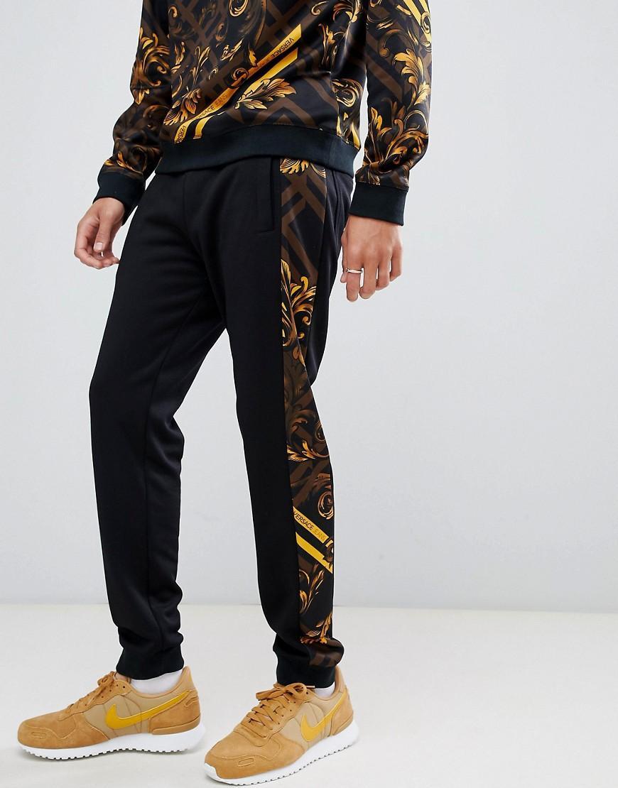 d47b01fad62cee Lyst - Versace Jeans Enge Jogginghose mit seitlichen Streifen mit ...