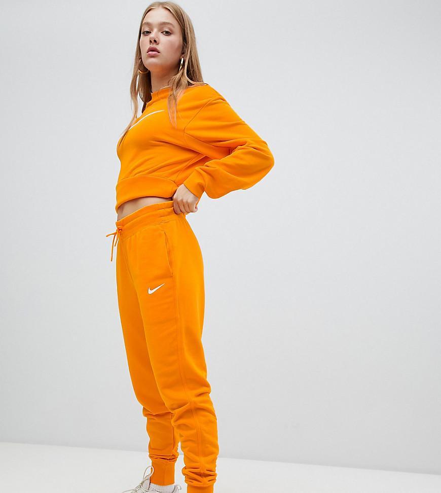 ensemble nike orange femme