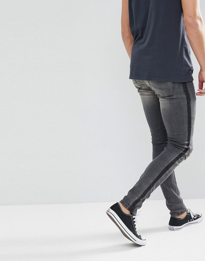 ASOS Denim Super Skinny Jeans In Washed Black With Side Stripe And Knee Rips for Men