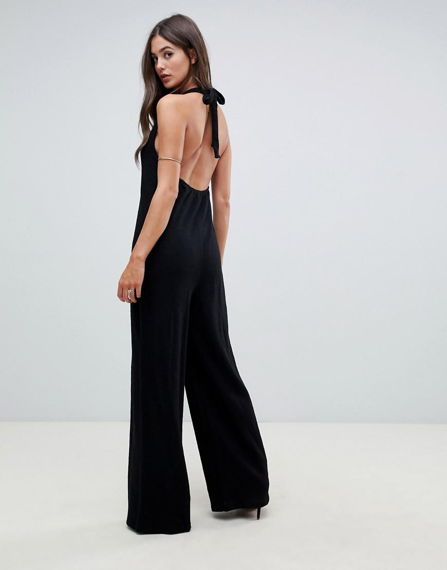 0e438c3f9da ASOS Asos Design Tall Halter Neck Jumpsuit With Plunge Front in Black - Lyst