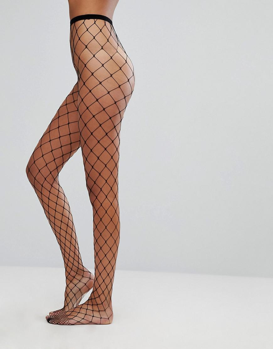 3c43d693979a1 ASOS 2 Pack Oversized Fishnet Tights In Black And Green - Lyst