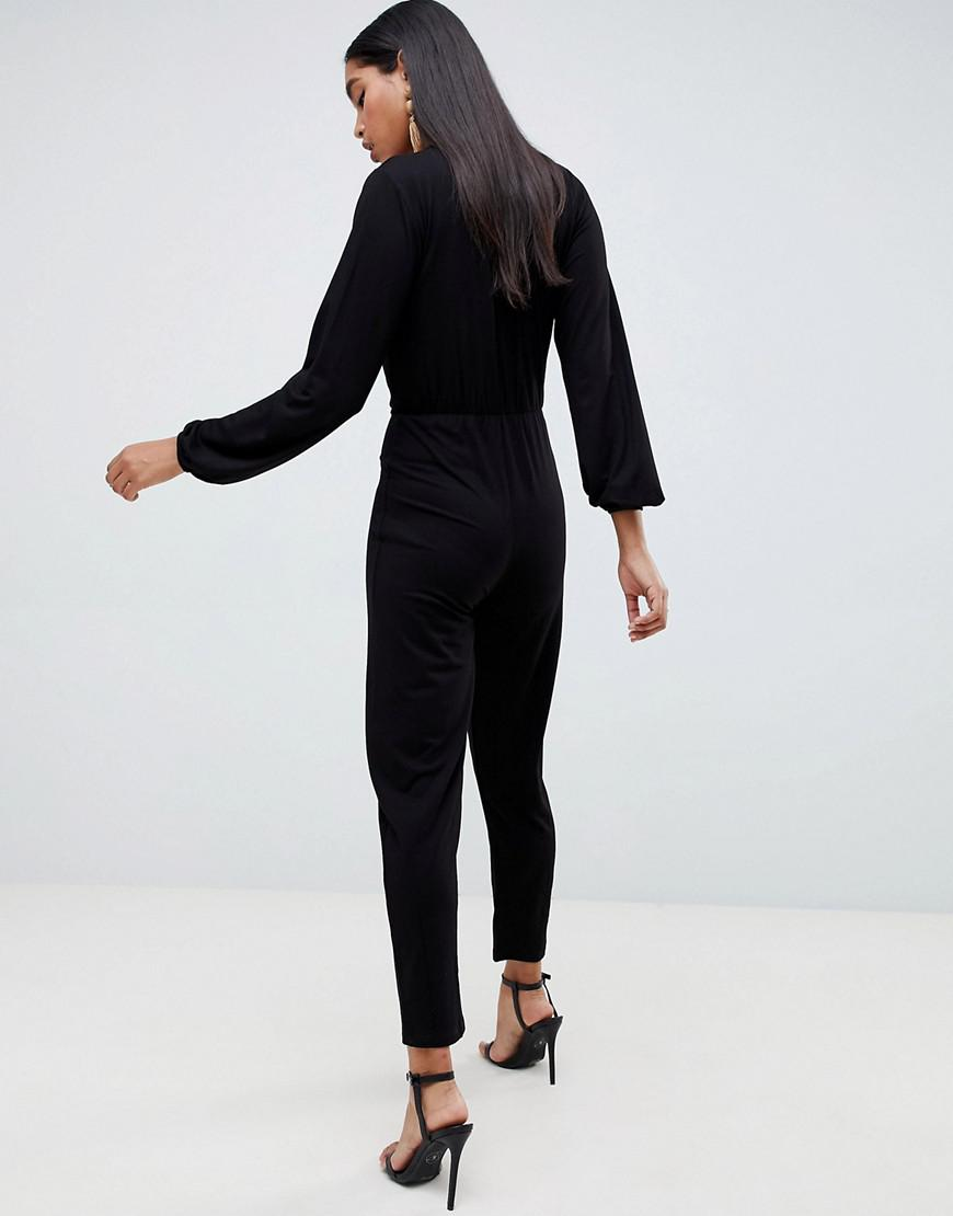 f354e4a9914e Lyst - ASOS Long Sleeve Jumpsuit With Wrap Front And Peg Leg in Black