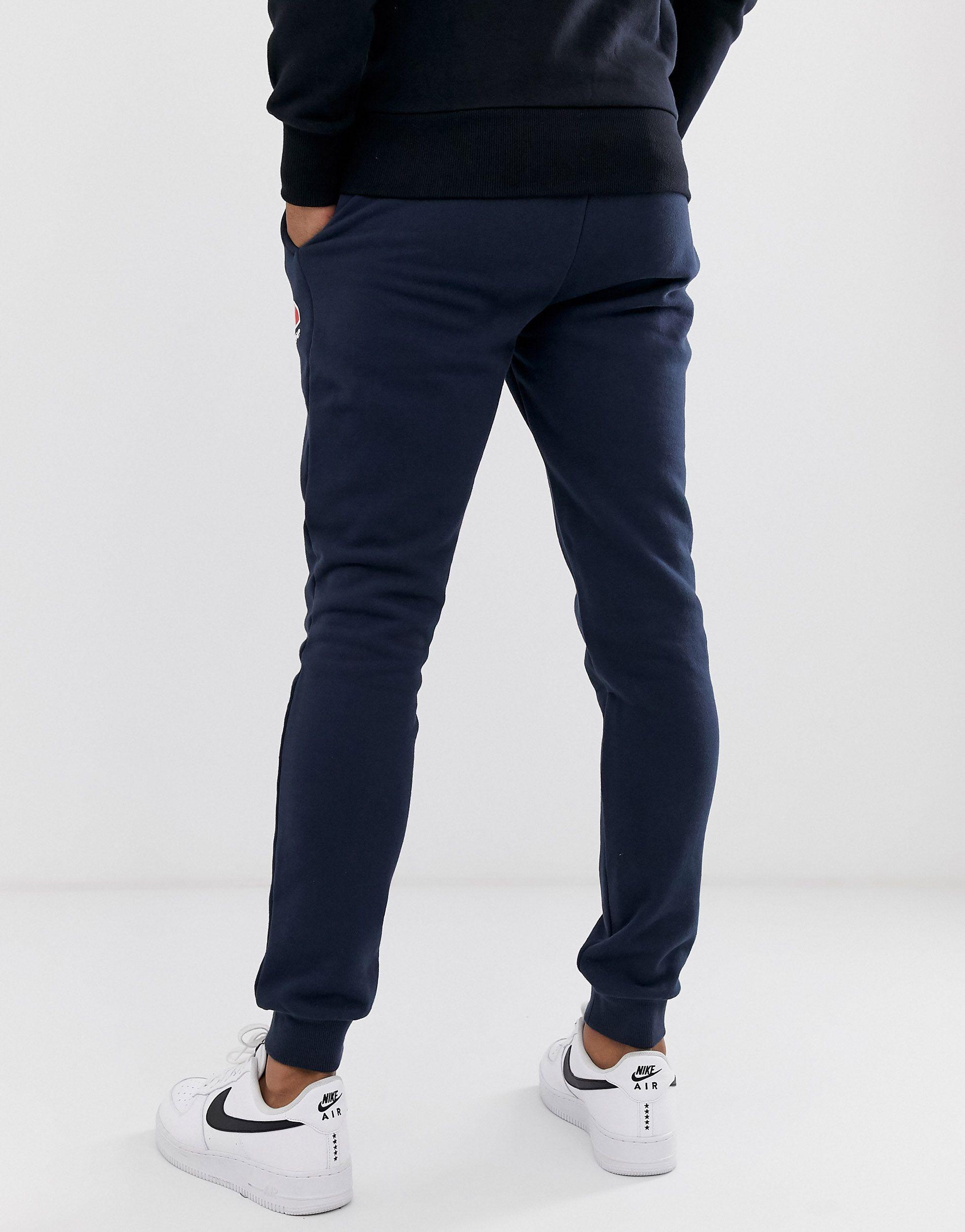 Ellesse Fleece Ovest Skinny joggers in Navy (Blue) for Men