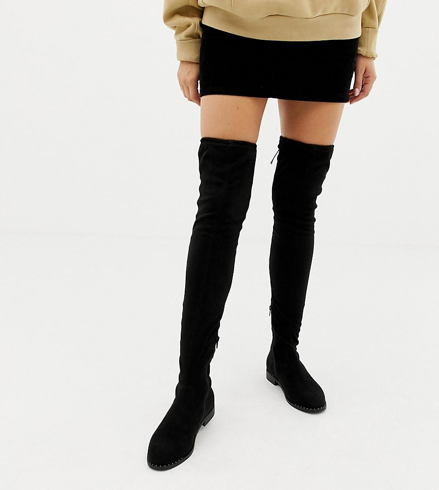 10737933b5a Lyst - ASOS Wide Fit Kaska Flat Studded Thigh High Boots in Black ...