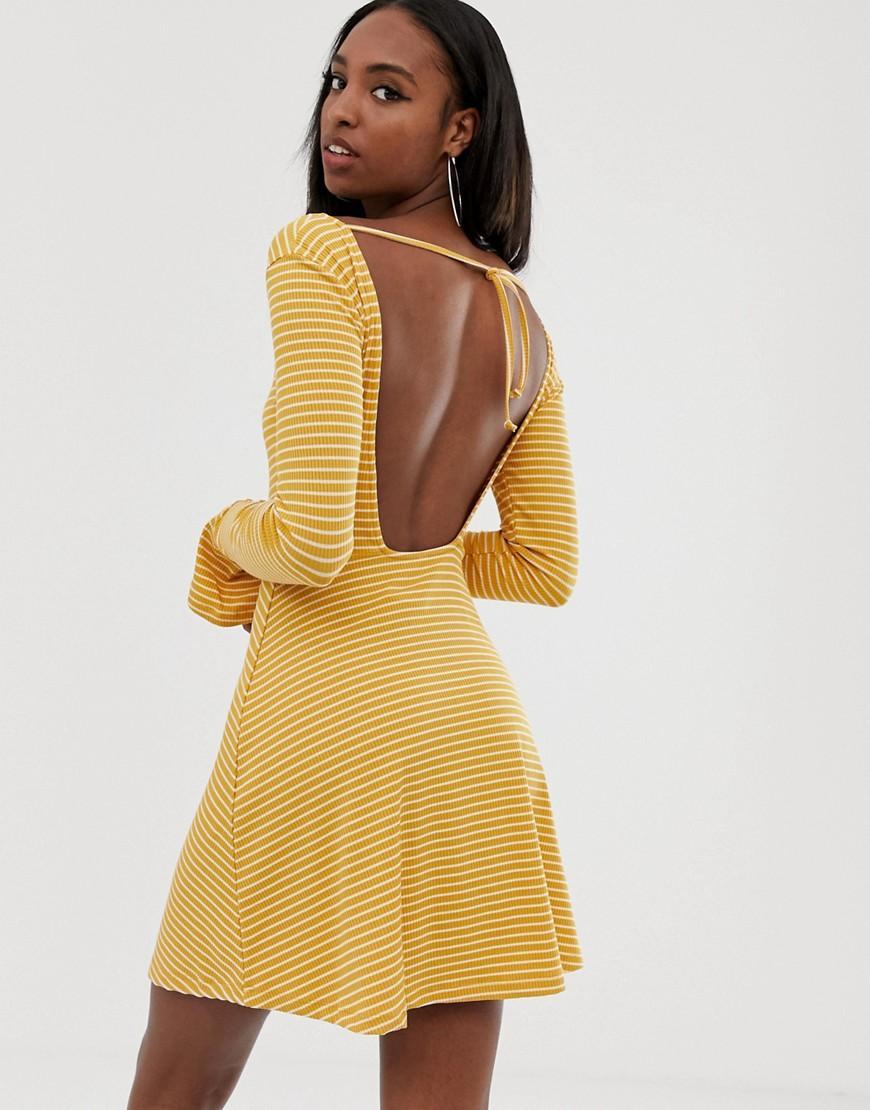 59e1b48f17 Lyst - ASOS Asos Design Tall Open Back Mini Skater Dress With Faux  Tortoiseshell Detail In Rib Stripe in Yellow