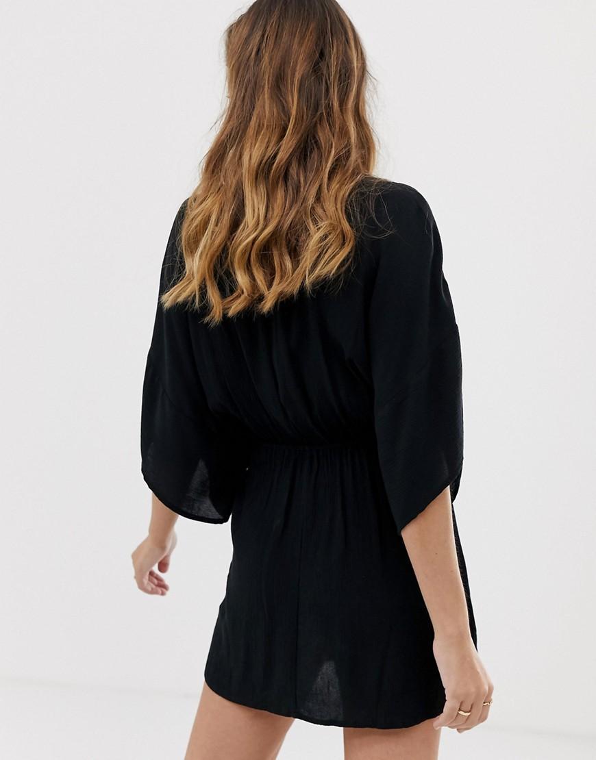 1cffa81c85 Lyst - ASOS Asos Design Petite Plunge Tie Waist Kimono Sleeve Crinkle Beach  Cover Up In Black in Black
