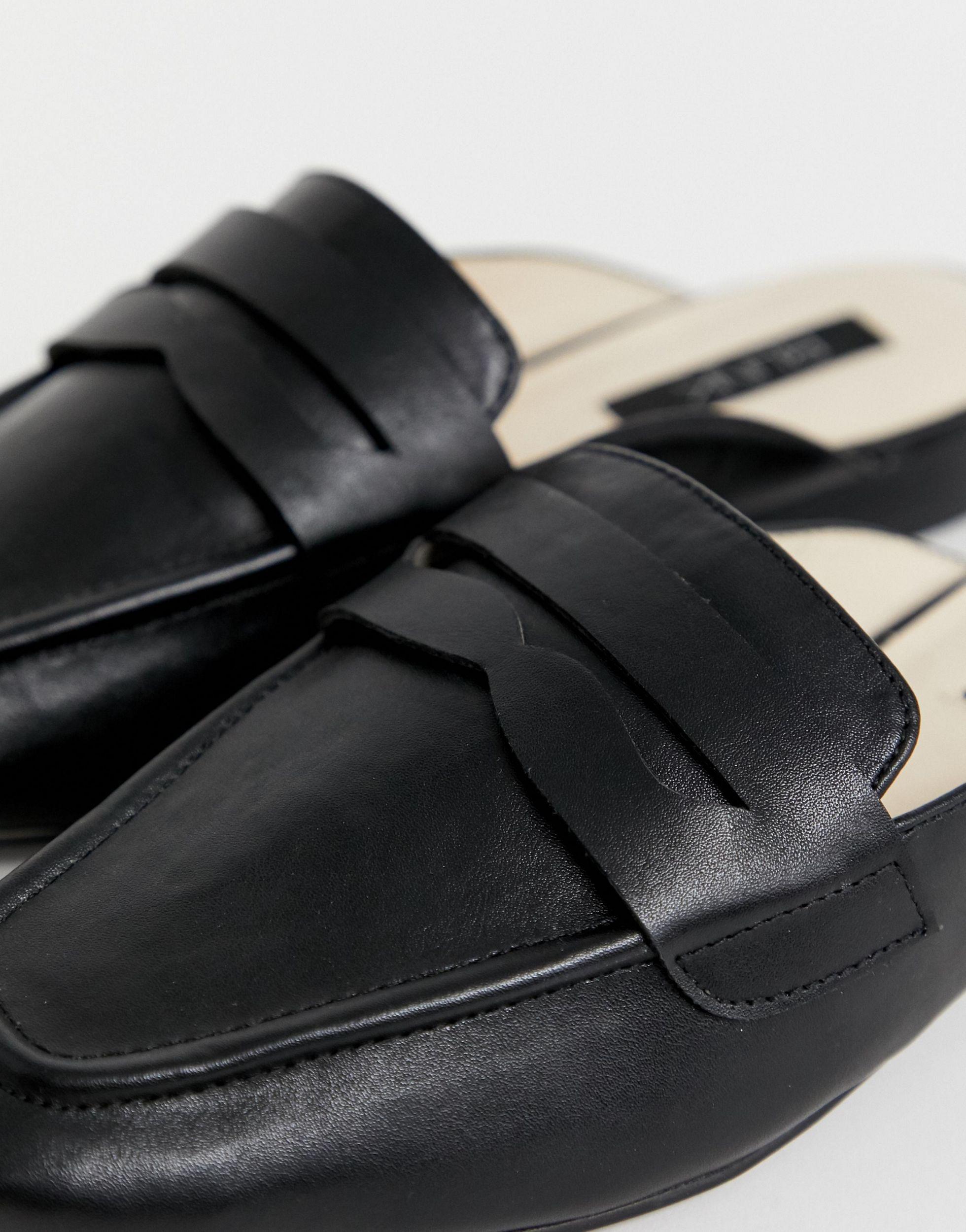 Mules planos con puntera cuadrada Blink de Caucho de color Negro