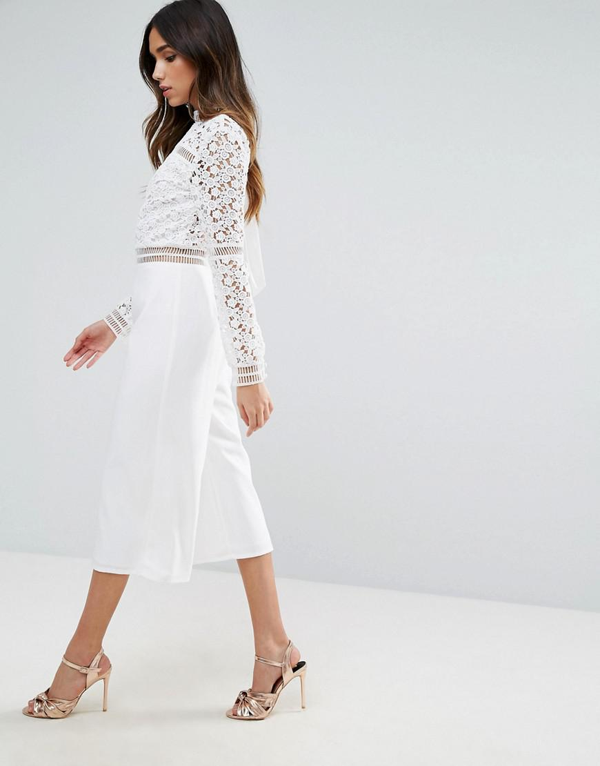 e261113325d Lyst - ASOS Premium Lace Jumpsuit With Open Back And Culotte Leg in ...