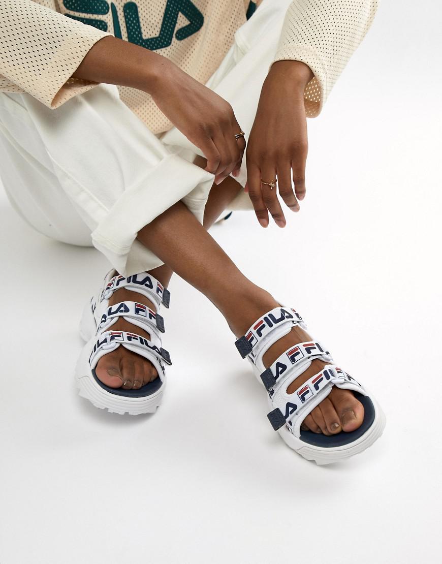 b016cfedb825 Lyst - Fila White Logo Strap Disruptor Sandal in White