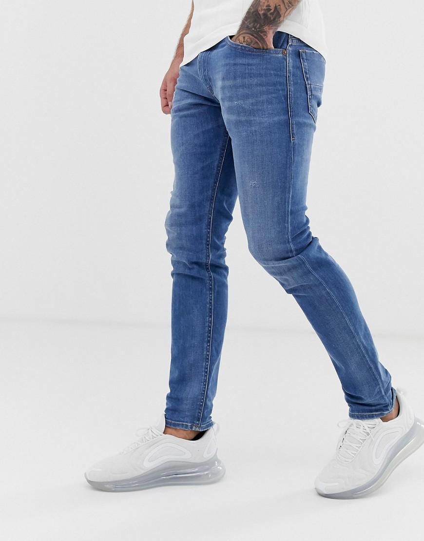 73e8dc55 DIESEL. Men's Blue Thommer Stretch Slim Fit Jeans In 083ax Light Wash