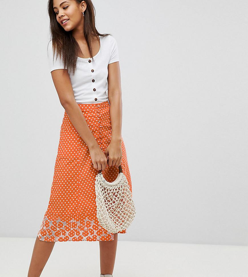 f1695ade4 Falda midi con estampado de lunares y bajo bordado de mujer de color naranja
