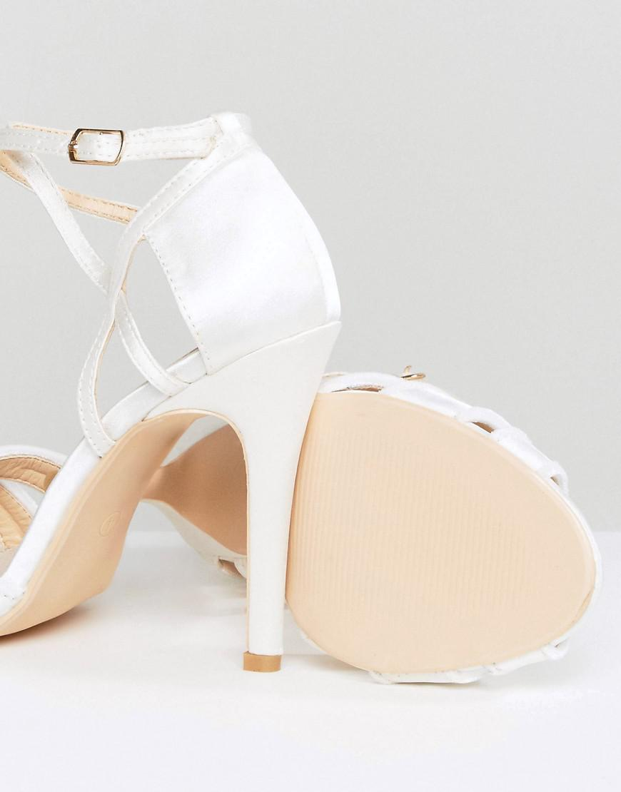 57970930aef True Decadence White Ivory Strappy Bow Heeled Sandals