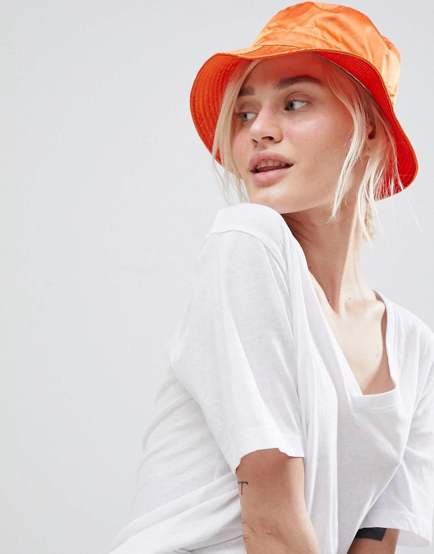 a6e0b3349d498 ASOS Satin Bucket Hat in Orange - Lyst