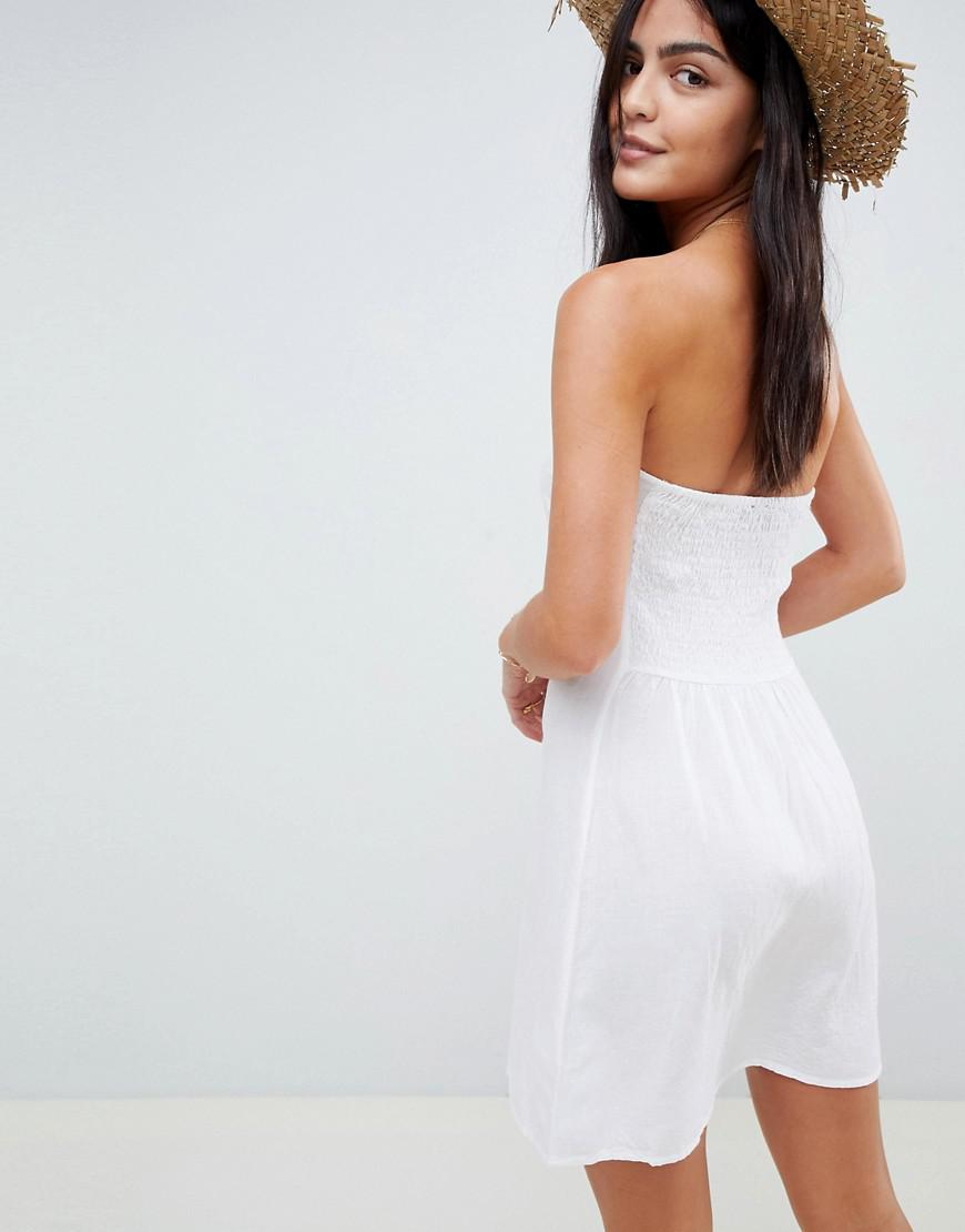 a03e3067ad Lyst - Akasa Exclusive Bandeau Button Front Beach Dress in White