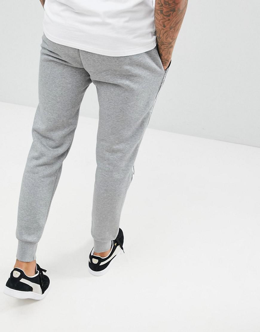 6a5b5af82771 PUMA Taping Joggers In Grey 85241803 in Gray for Men - Lyst