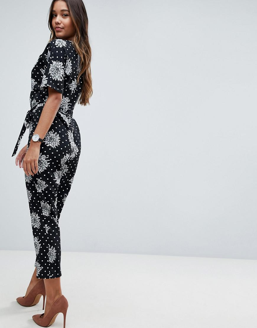 f10242ce0837 ASOS Asos Wrap Jumpsuit With Self Belt In Mono Spot Floral Print in Black -  Lyst