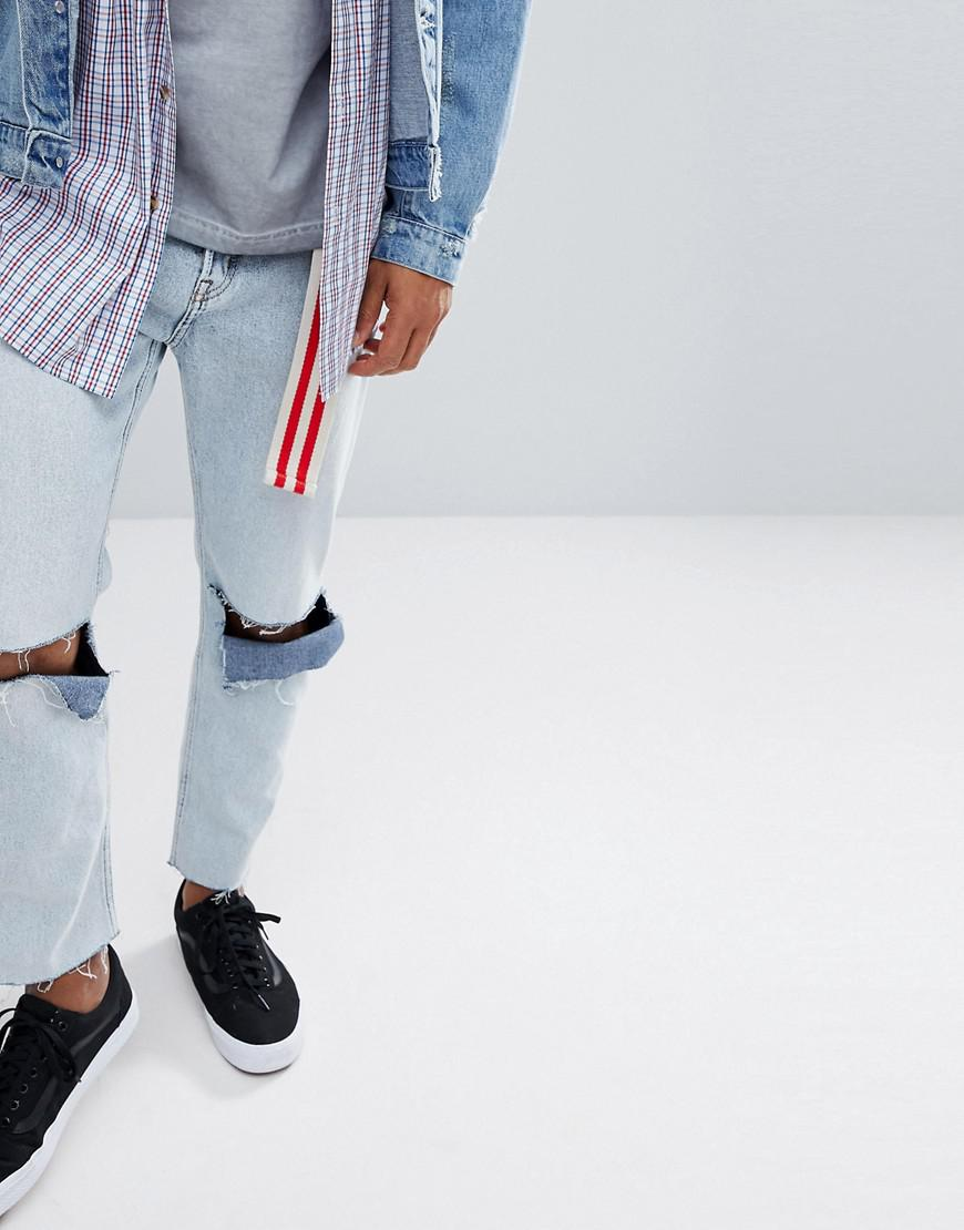 05cb6c996b5 Cheap Monday In Law Tapered Jeans In Tom Blue With Blown Out Knee in ...