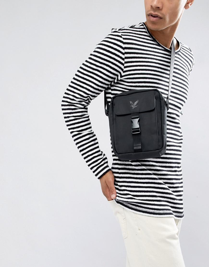 af2b96ba43b0 Lyle   Scott Reflective Logo Flight Bag In Black in Black for Men - Lyst