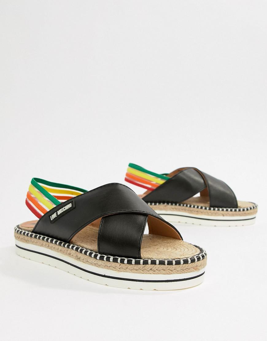49a5fe34a201 Lyst - Love Moschino Rainbow Flat Sandals in Black