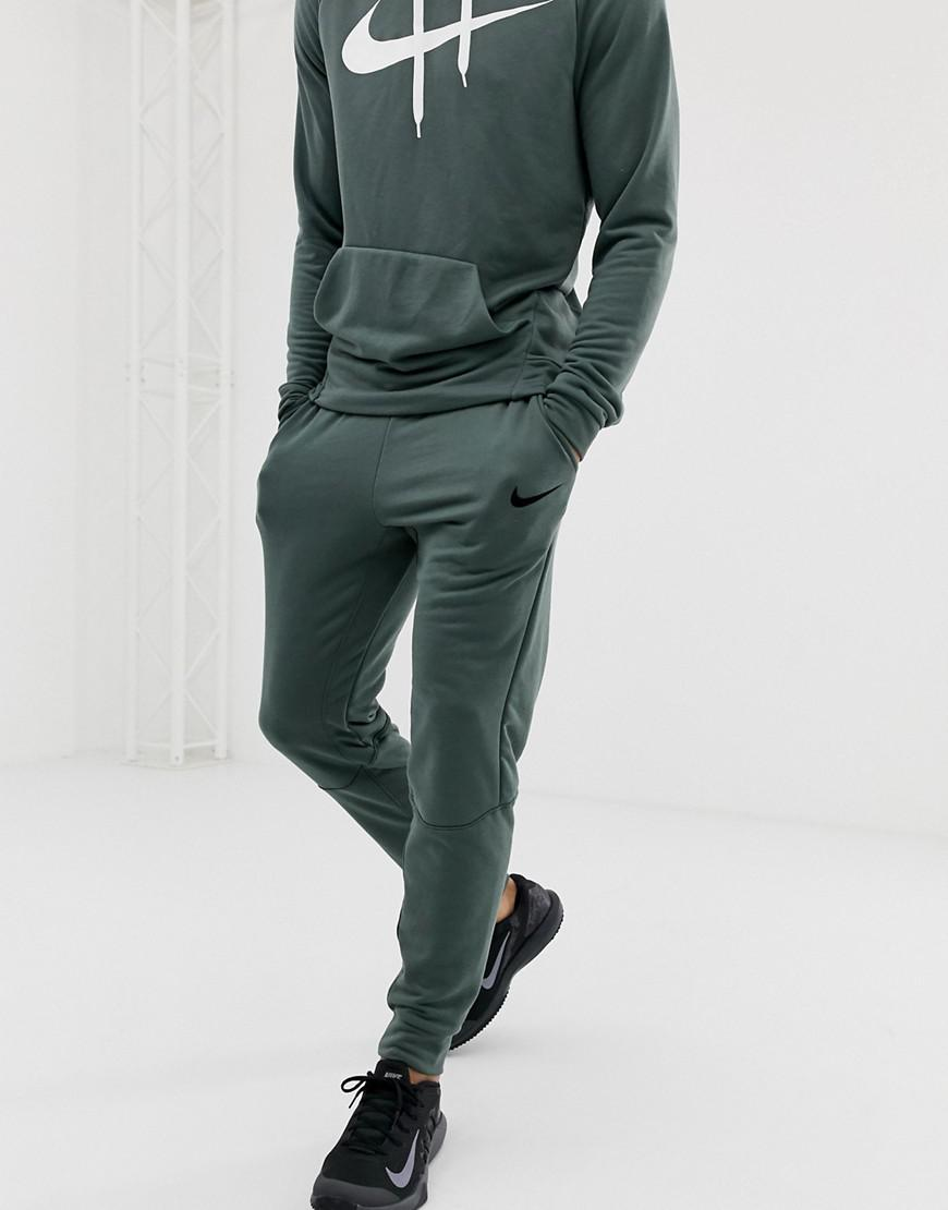 3de583f0bb Nike Dry Tapered Pants In Green in Green for Men - Lyst
