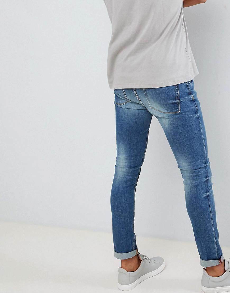 Noak Denim Skinny Jeans In Mid Blue Wash for Men