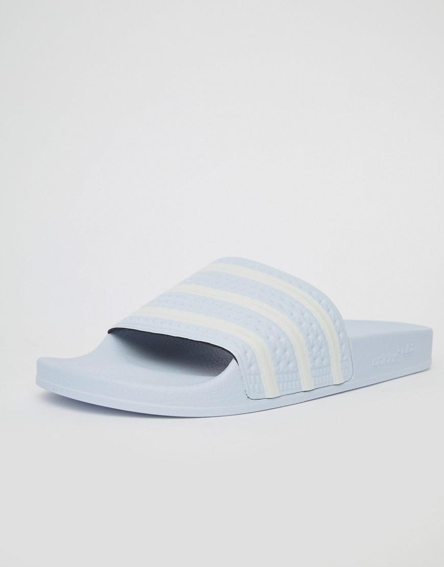 b40fef5f0 adidas Originals Adilette Sliders In Blue B41546 in Blue for Men - Lyst